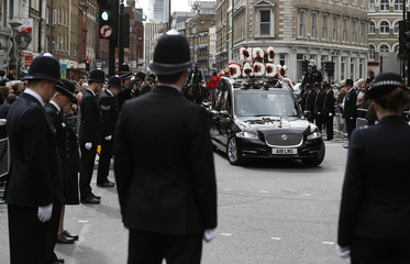 Police officers line the street as the coffin of PC Keith Palmer, who was killed in the recent Westminster attack, is transported from the Palace of Westminster, where it laid overnight, to his funeral at Southwark Cathedral in central London