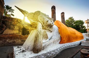 Sleeping Buddha statue at sunset, Wat Yai Chaimongkhon Temple, Ayutthaya, Thailand