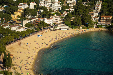 Aerial view of Canyelles beach in the city of Roses, on the Costa brava at sunset