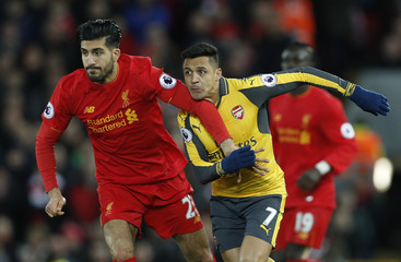 Arsenal's Alexis Sanchez in action with Liverpool's Emre Can