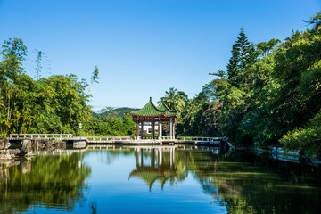 Beautiful chinese traditional garden with water pond in Nanshan temple. Hainan province, China.