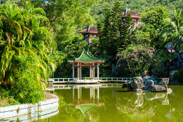 Beautiful garden with water pond in Nanshan temple. Hainan province, China.