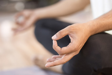Close-up of man meditating