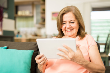 Elder woman having fun with technology