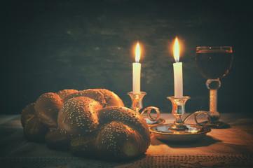 Low key shabbat image. challah bread, shabbat wine and candles