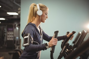 Fit woman exercising on a treadmill
