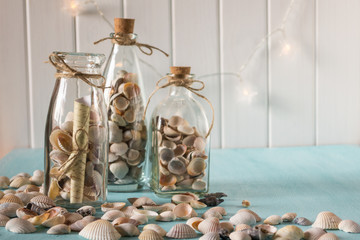 Idea of interior decoration with seashells and glass bottles. Marine concept.