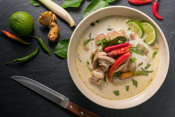 Chicken coconut soup (Tom Kha Gai), Thai food on black stone table background