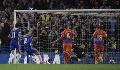 Chelsea's Eden Hazard scores their second goal after having his penalty saved
