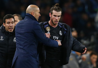 Real Madrid coach Zinedine Zidane with Real Madrid's Gareth Bale