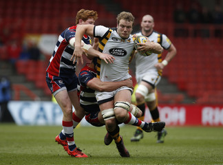 Wasps' Joe Launchbury is tackled by Bristol's Jack Tovey (left) and Sam Jeffries