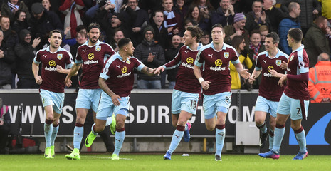 Burnley's Andre Gray (C) celebrates scoring their first goal with team mates