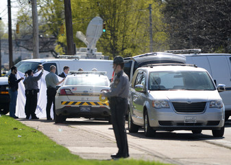 Police prepare to remove the body of Steven Stephens in Erie