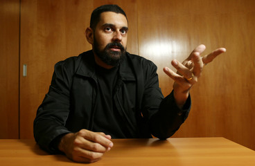 """Brazilian health inspector and whistleblower of the investigation, dubbed """"Operation Weak Flesh,"""" Teixeira, gestures as he poses for picture in Brasilia"""
