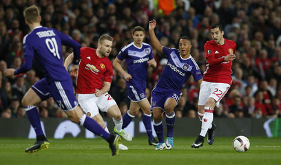 Anderlecht's Youri Tielemans in action with Manchester United's Henrikh Mkhitaryan and Luke Shaw