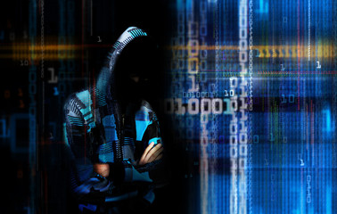 An adult online anonymous internet hacker with invisible face