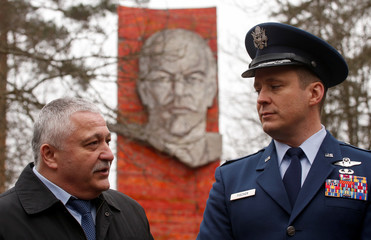 International Space Station (ISS) crew members U.S. astronaut Fischer and Russian cosmonaut Yurchikhin pose in front of the stele to Soviet Union founder Vladimir Lenin during a traditional farewell ceremony in Star City outside Moscow