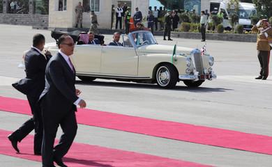 Jordan's King Abdullah II and Saudi Arabia's King Salman bin Abdulaziz Al Saud sit in a car during a welcoming ceremony at the airport in Amman