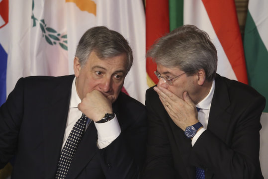 Italy's PM Gentiloni and European Parliament Prersident Tajani whisper during the EU leaders meeting on the 60th anniversary of the Treaty of Rome, in Rome
