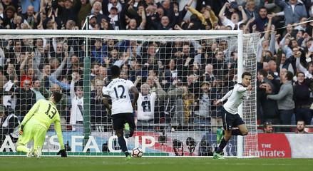 Tottenham's Dele Alli celebrates scoring their second goal as Chelsea's Thibaut Courtois looks dejected