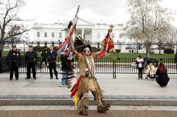 Indigenous activist dances during protest march and rally in front of White House in Washington