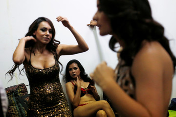 """A porn actress sits backstage during a news conference to promote the """"Expo Sex and Eroticism"""" adult exhibition in Mexico City"""