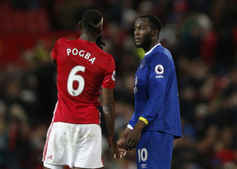 Manchester United's Paul Pogba and Everton's Romelu Lukaku after the game