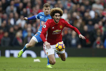 Manchester United's Marouane Fellaini in action with Bournemouth's Ryan Fraser