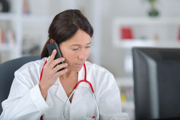 portrait of female doctor on the phone in her office