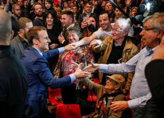 Emmanuel Macron, head of the political movement En Marche ! (Onwards !) and a candidate for the 2017 presidential election, arrives at a campaign rally in Dijon