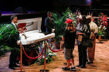 Chuck Berry lies in repose in an open casket as fans pay their respects to the late rock 'n' roll visionary during his funeral at The Pageant club in St. Louis
