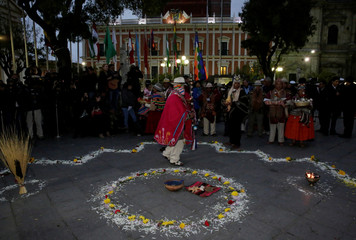 Aymara's witch doctors participate in an Andean ritual during a vigil aimed at bringing luck to their maritime claim against Chile to the International Court of Justice in the Hague, at the Murillo square in La Paz