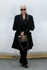 British singer Lily Allen poses during a photocall before the French fashion house Chanel Fall/Winter 2017-2018 women's ready-to-wear collection show during Fashion Week in Paris