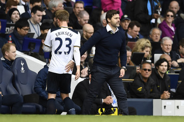 Tottenham's Christian Eriksen walks past manager Mauricio Pochettino as he is substituted