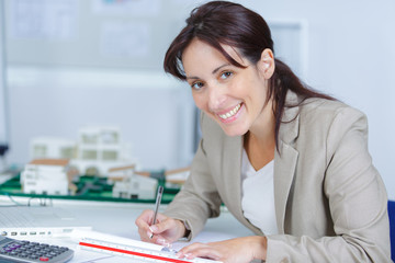 young attractive woman sitting in office