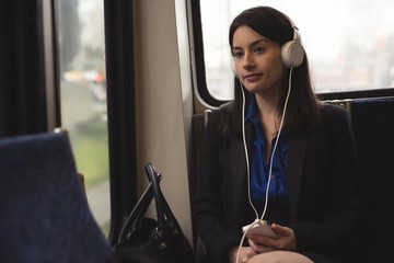 Woman listening music on phone