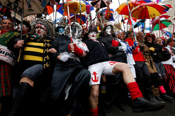 "People wear local carnival costumes during the parade of ""Carnaval de Dunkerque"" in Dunkirk"