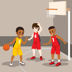 Young boys playing basketball sport match competition