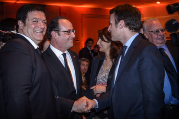 French President Hollande greets, Macron, head of the political movement En Marche !, or Onwards !, and candidate for the 2017 French presidential election during the annual CRIF dinner in Paris