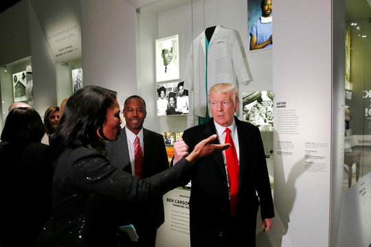 U.S. President Trump and Carson look at the exhibit dedicated to Carson's neurosurgery career during a visit to the National Museum of African American History in Washington