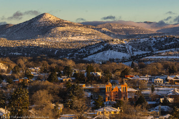 Old church and small mountain town in morning light