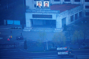 Military trucks carry soldiers through central Pyongyang before sunset as the capital preparers for a parade marking today's 105th anniversary of the birth of Kim Il Sung, North Korea's founding father and grandfather of the current ruler
