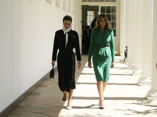 U.S. first lady Melania Trump (R) walks with Jordan's Queen Rania at the White House in Washington