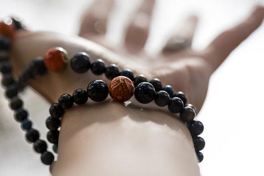 Woman's hand with a mala bracelet