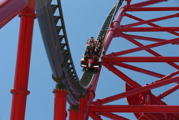 "People ride in the ""Red Force"" roller coaster during the inauguration of Ferrari Land"