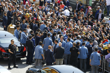 Media surround Turkish President Tayyip Erdogan next to the polling station during a referendum in Istanbul