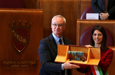 """Former Leicester City coach Claudio Ranieri (L) receives the """"Lupa Capitolina award"""" from Rome's mayor Virginia Raggi during a ceremony at Rome's city hall"""
