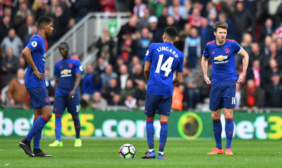 Manchester United's Marcus Rashford, Jesse Lingard and Michael Carrick look dejected after Middlesbrough's Rudy Gestede scores their first goal