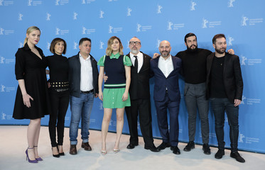 Cast members pose during a photocall to promote the movie 'The Bar' at the 67th Berlinale International Film Festival in Berlin