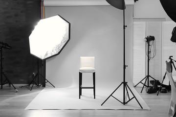Modern photo studio with professional lighting equipment